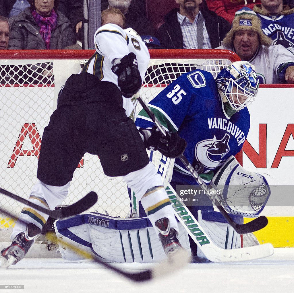 Antoine Roussel #60 of the Dallas Stars looks for a rebound after the save by goalie Cory Schneider #35 of the Vancouver Canucks in the second period of NHL action on February 15, 2013 at Rogers Arena in Vancouver, British Columbia, Canada.