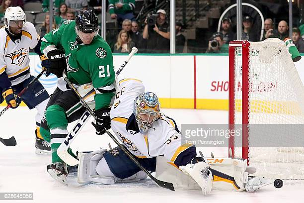 Antoine Roussel of the Dallas Stars shoots the puck against Pekka Rinne of the Nashville Predators in the first period at American Airlines Center on...