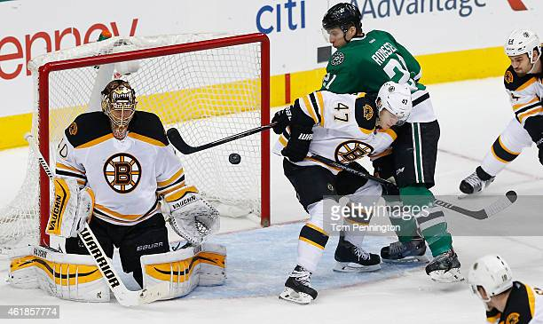 Antoine Roussel of the Dallas Stars tries to control the puck against Torey Krug of the Boston Bruins and Tuukka Rask of the Boston Bruins at...