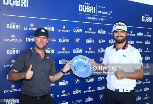 Antoine Rozner of France celebrates with caddie Darren Reynolds following victory during Day Four of the Golf in Dubai Championship at Jumeirah Golf...
