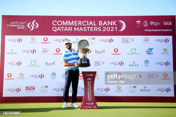 Antoine Rozner of France poses with the trophy during Day Four of the Commercial Bank Qatar Masters at Education City Golf Club on March 14, 2021 in...