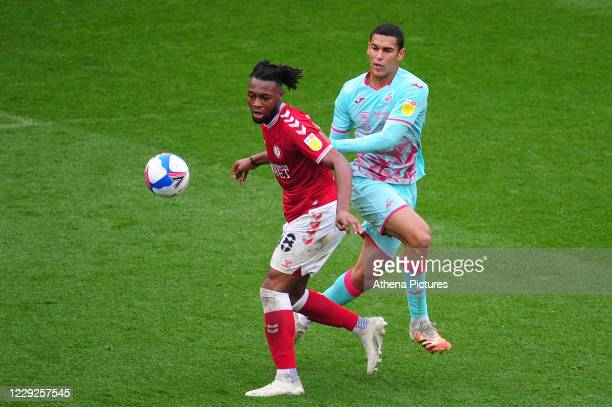 Antoine Semenyo of Bristol City under pressure from Ben Cabango of Swansea City during the Sky Bet Championship match between Bristol City and...