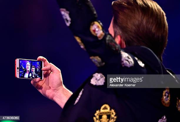 Antoine takes a selfie togehter with Severino Seeger during the finals of the television show 'Deutschland sucht den Superstar' on May 16 2015 in...