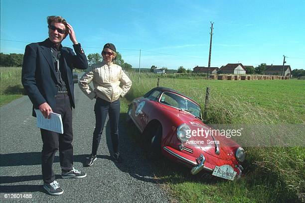 Antoine Van Doorne and Sally Woodford with their 1963 Prince of Europe Porsche in the ditch owing to a brake problem