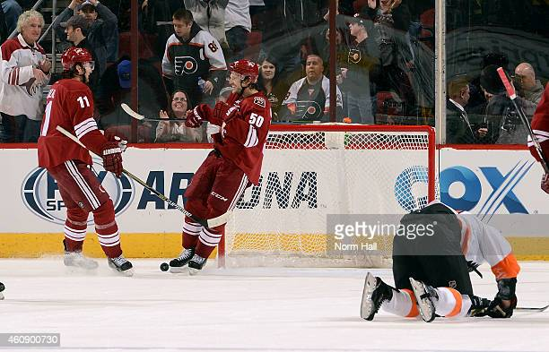 Antoine Vermette and Martin Hanzal of the Arizona Coyotes celebrate Vermette's empty net goal against the Philadelphia Flyers at Gila River Arena on...