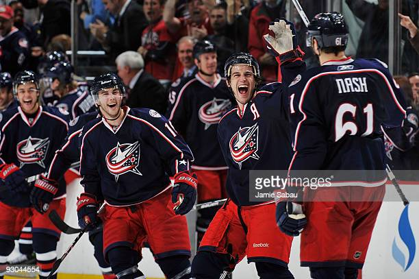 Antoine Vermette comes out to congratulate Rick Nash, both of the Columbus Blue Jackets, after Nash scored the game winning goal in a shootout...