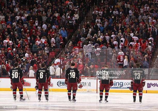 Antoine Vermette, David Schlemko, Shane Doan, Mikkel Boedker and Oliver Ekman-Larsson of the Phoenix Coyotes line up before the NHL game against the...