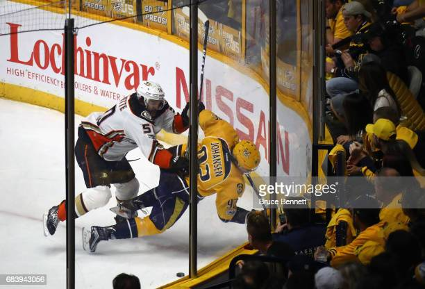 Antoine Vermette of the Anaheim Ducks checks Ryan Johansen of the Nashville Predators during the first period in Game Three of the Western Conference...