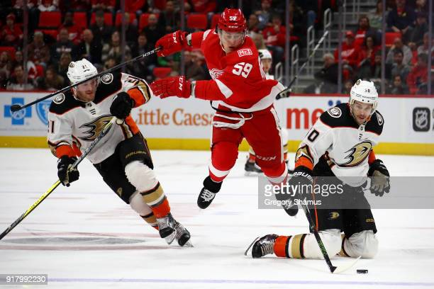 Antoine Vermette of the Anaheim Ducks tries to control the puck in front of Tyler Bertuzzi of the Detroit Red Wings during the third period at Little...