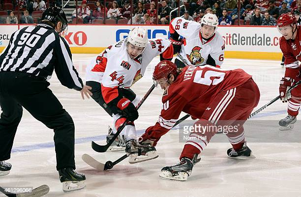 Antoine Vermette of the Arizona Coyotes and JeanGabriel Pageau of the Ottawa Senators battle for a faceoff during the first period at Gila River...
