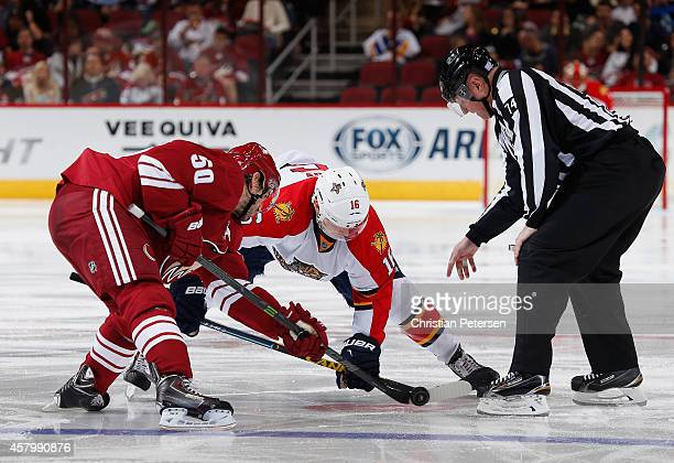 Antoine Vermette of the Arizona Coyotes faces off against Aleksander Barkov of the Florida Panthers during the NHL game at Gila River Arena on...