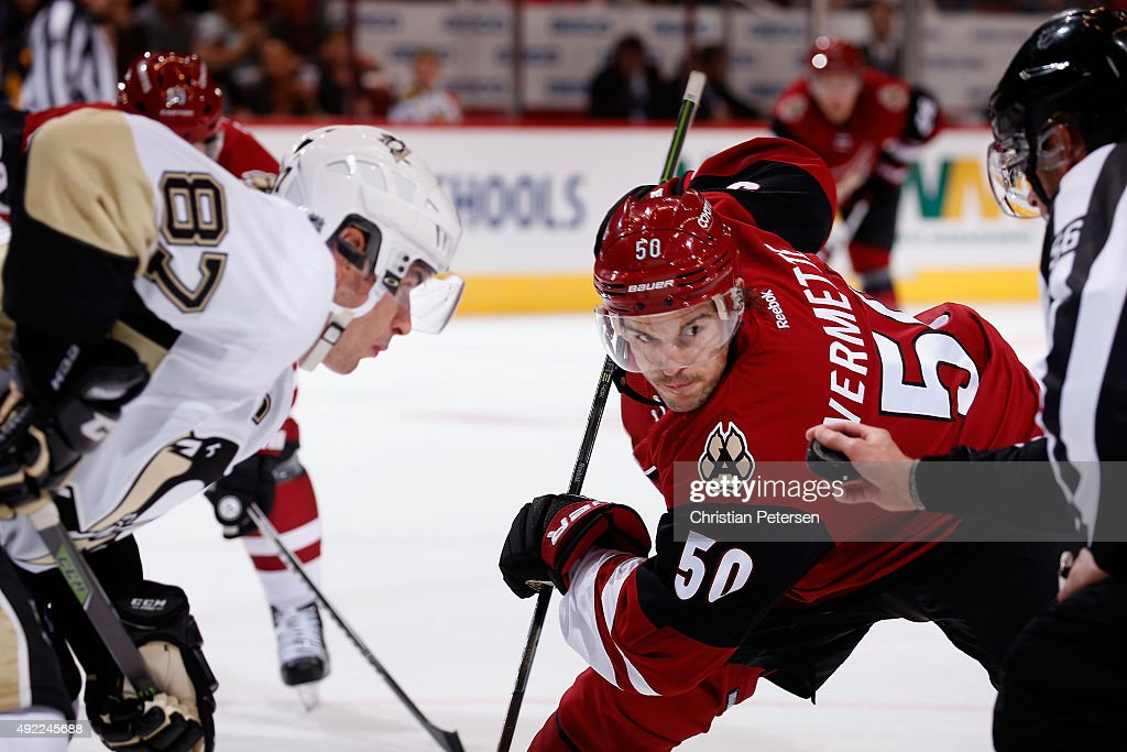 Antoine Vermette #50 of the Arizona Coyotes faces off against Sidney Crosby #87 of the Pittsburgh Penguins during the NHL game at Gila River Arena on October 10, 2015 in Glendale, Arizona. The Coyotes defeated the Penguins 2-1.