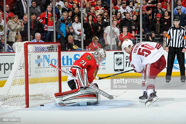 Antoine Vermette of the Arizona Coyotes scores on goalie Antti Raanta of the Chicago Blackhawks in the shootout during the NHL game at the United...