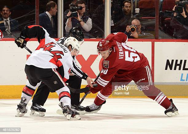Antoine Vermette of the Arizona Coyotes takes a faceoff against JeanGabriel Pageau of the Ottawa Senators at Gila River Arena on January 10 2015 in...