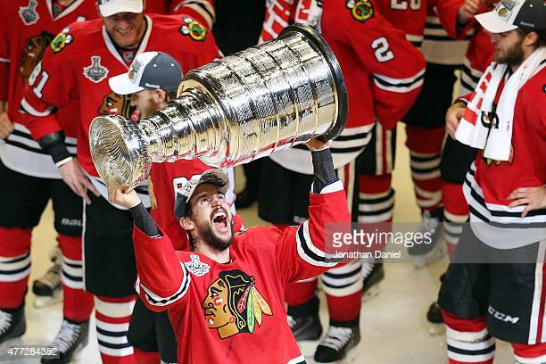 Antoine Vermette of the Chicago Blackhawks celebrates by hoisting the Stanley Cup after defeating the Tampa Bay Lightning by a score of 20 in Game...