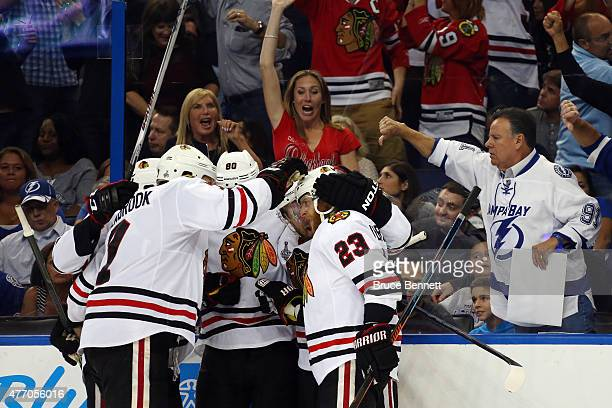Antoine Vermette of the Chicago Blackhawks celebrates with his teammates after scoring a goal in the third period against the Tampa Bay Lightning...