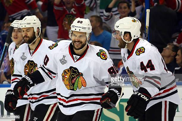 Antoine Vermette of the Chicago Blackhawks celebrates with Kimmo Timonen after scoring a goal in the third period against the Tampa Bay Lightning...