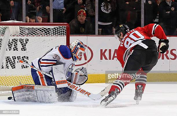 Antoine Vermette of the Chicago Blackhawks scores the gamewinning goal in the shootout against Ben Scrivens of the Edmonton Oilers at the United...