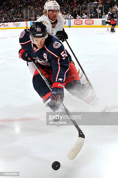 Antoine Vermette of the Columbus Blue Jackets and Michael Ryder of the Dallas Stars battle for a loose puck during the second period on October 18...