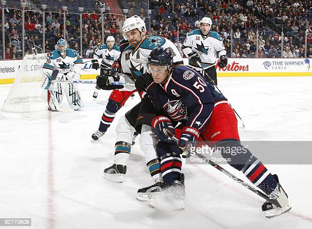 Antoine Vermette of the Columbus Blue Jackets chases the puck into the corner in front of Dan Boyle of the San Jose Sharks on November 4 2009 at...