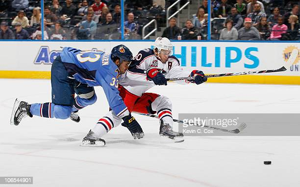 Antoine Vermette of the Columbus Blue Jackets takes a shot on goal against Dustin Byfuglien of the Atlanta Thrashers at Philips Arena on November 4...