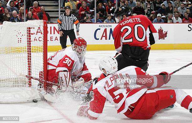 Antoine Vermette of the Ottawa Senators looks for a rebound as Chris Osgood of the Detroit Red Wings makes a save at Scotiabank Place on October 11...