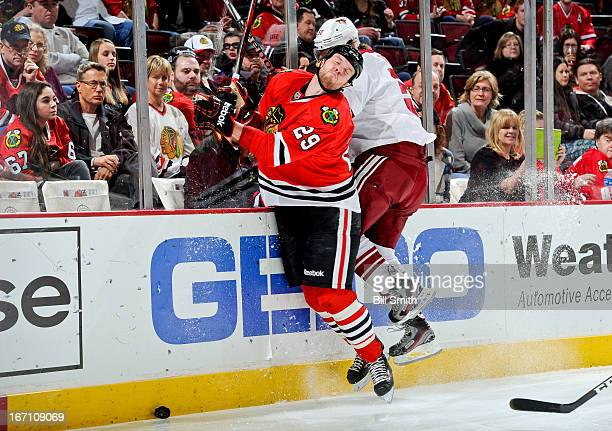 Antoine Vermette of the Phoenix Coyotes gets called for highsticking against Bryan Bickell of the Chicago Blackhawks during the NHL game on April 20...