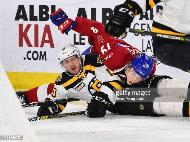 Antoine Waked of the Laval Rocket falls on top of Lee Stempniak of the Providence Bruins during the AHL game at Place Bell on March 20, 2019 in...