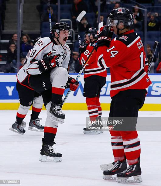 Antoine Waked of the Rouyn-Noranda Huskies celebrates his teammate game tying goal late in the third period against the Quebec Remparts during their...