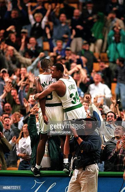 Antoine Walker finds himself celebrating on the scorers' table with Paul Pierce after Walker hit a three pointer to beat the Miami Heat in the last...