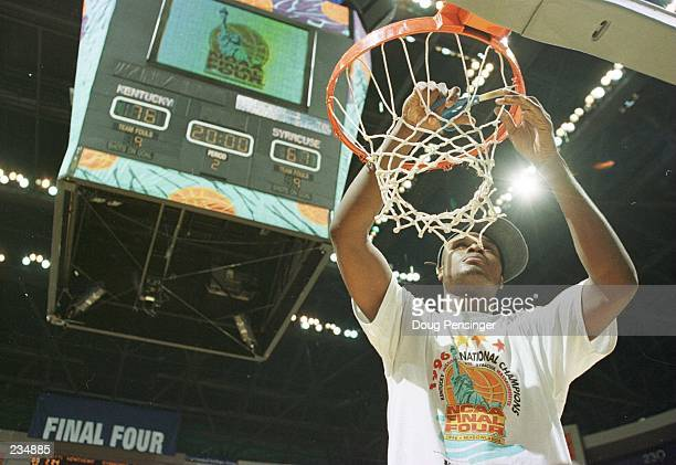 Antoine Walker of Kentucky cuts a section of the net at the end of the 1996 NCAA Men''s Basketball Championship at the Continental Air Arena in East...