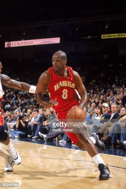 Antoine Walker of the Atlanta Hawks moves the ball during the game against the Golden State Warriors at The Arena in Oakland on February 23 2005 in...