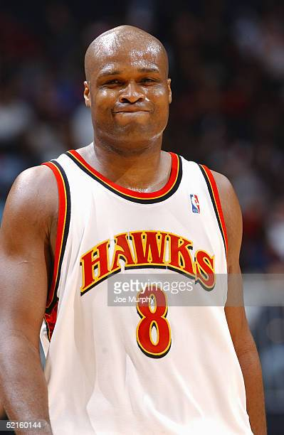 Antoine Walker of the Atlanta Hawks walks on the court during the game against the Miami Heat at Philips Arena on January 28 2005 in Atlanta Georgia...