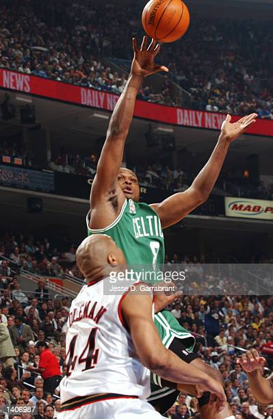 Antoine Walker of the Boston Celtics attempts a shot over Derrick Coleman of the Philadelphia 76ers during game 4 of the Eastern Conference...