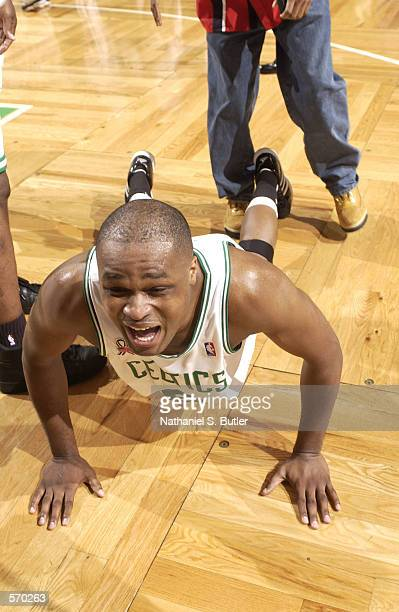 Antoine Walker of the Boston Celtics does a pushup of joy in a victory against the New Jersey Nets during Eastern Conference Final game 3 at the...