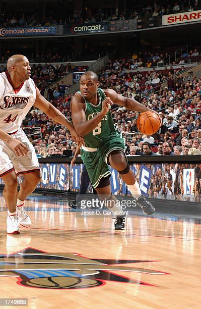 Antoine Walker of the Boston Celtics drives against Derrick Coleman of the Philadelphia 76ers during the NBA game at First Union Center on January...