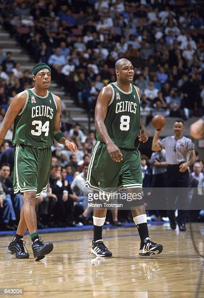 Antoine Walker of the Boston Celtics walks next to his teammate Paul Pierce during game 2 of the Eastern Conference Finals during the 2002 NBA...