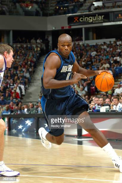 Antoine Walker of the Dallas Mavericks drives the ball against the Sacramento Kings October 22 2003 at Arco Arena in Sacramento California NOTE TO...
