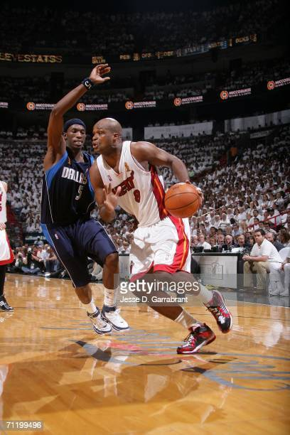 Antoine Walker of the Miami Heat drives against Josh Howard of the Dallas Mavericks during Game Three of the 2006 NBA Finals June 13 2006 at American...