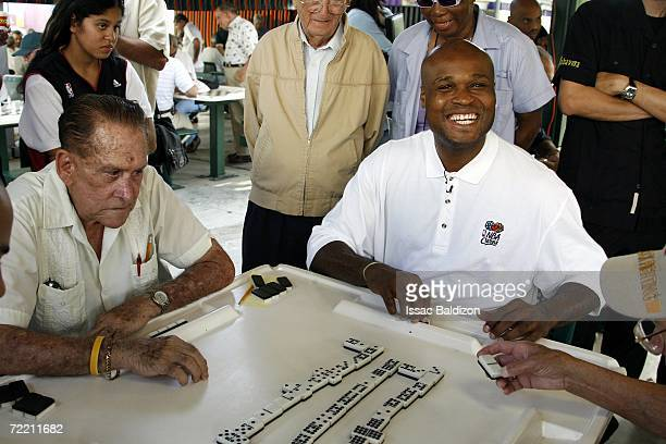 Antoine Walker of the Miami Heat learns to play domino as a part of the Miami Heat celebration of Hispanic Heritage Month on October 18 2006 at...
