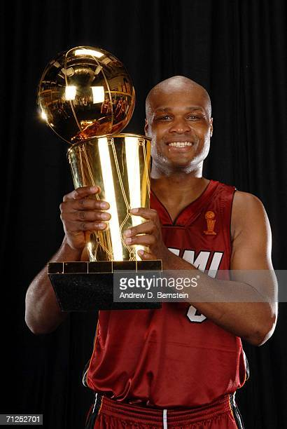 Antoine Walker of the Miami Heat poses for a portrait with the Larry O'Brien Championship trophy after their 9592 Game Six victory of the 2006 NBA...