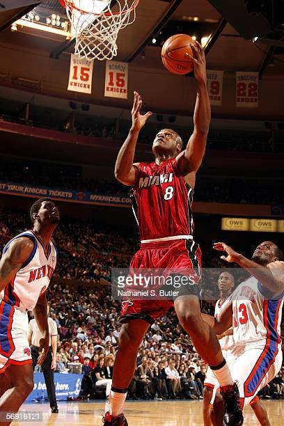 Antoine Walker of the Miami Heat shoots against Qyntel Woods of the New York Knicks on February 22 2006 at Madison Square Garden in New York City...