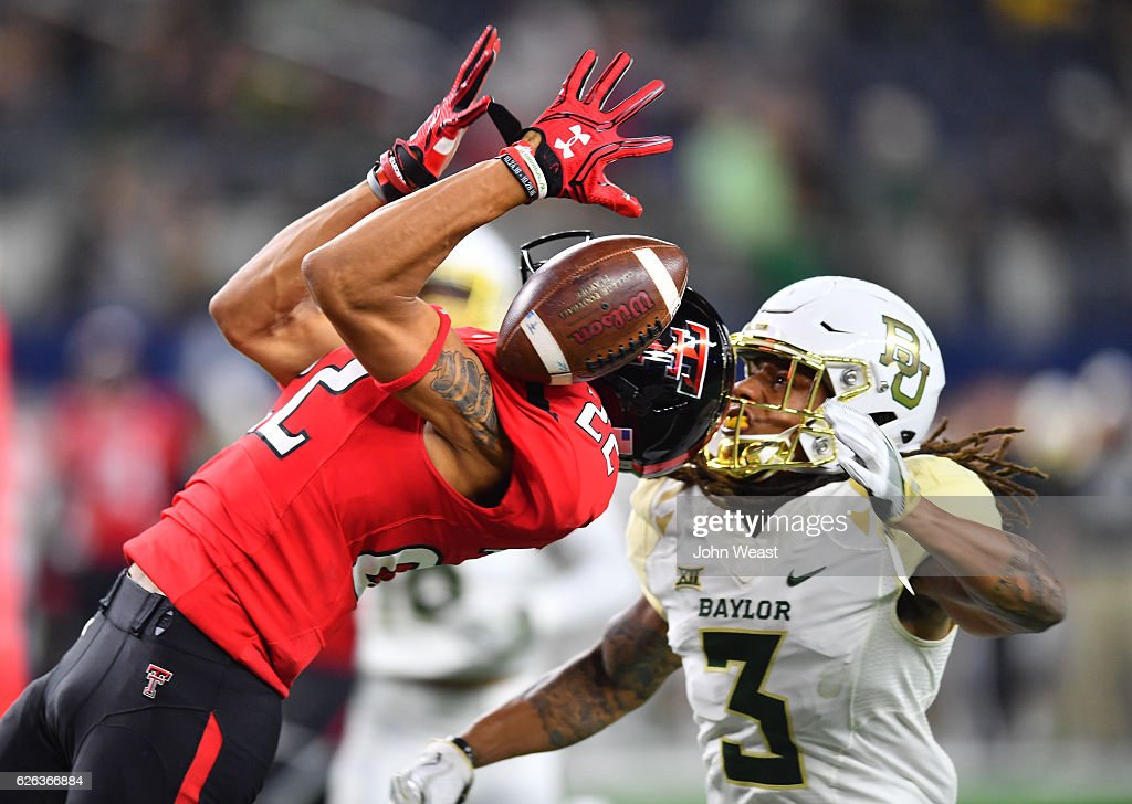 Antoine Wesley #22 of the Texas Tech Red Raiders cannot make the catch while defended by Tion Wright #3 of the Baylor Bears during the game on November 25, 2016 at AT&T Stadium in Arlington, Texas. Texas Tech defeated Baylor 54-35.