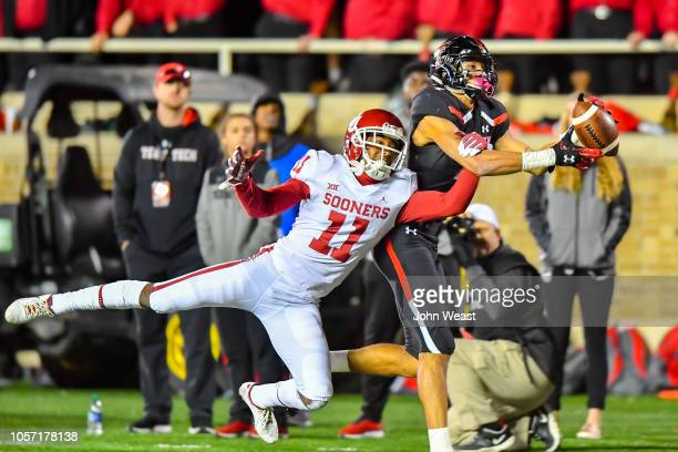 Antoine Wesley of the Texas Tech Red Raiders makes the catch against Parnell Motley of the Oklahoma Sooners during the second half of the game on...