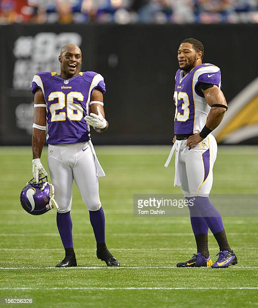 Antoine Winfield and Jamarca Sanford of the Minnesota Vikings talks during warms prior to an NFL game against the Detroit Lions at Mall of America...