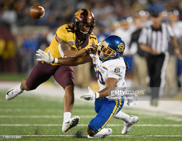 Antoine Winfield Jr #11 of the Minnesota Gophers breaks up a pass intended for Adam Anderson of the South Dakota State Jackrabbits during the first...