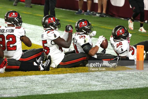Antoine Winfield Jr. #31 of the Tampa Bay Buccaneers celebrates with teammates in the third quarter after an interception against the Kansas City...