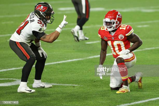 Antoine Winfield Jr. #31 of the Tampa Bay Buccaneers taunts Tyreek Hill of the Kansas City Chiefs during the fourth quarter in Super Bowl LV at...