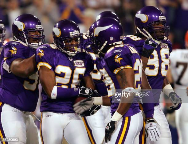 Antoine Winfield of the Minnesota Vikings is congratulated by teammate Brian Williams after Winfield intercepted a pass from Trent Dilfer of the...