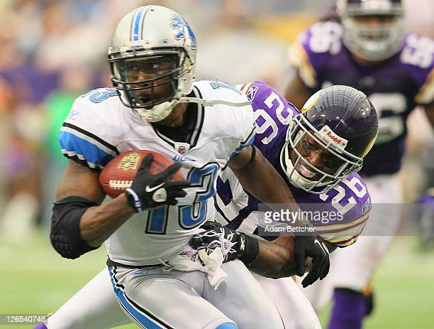 Antoine Winfield of the Minnesota Vikings makes the tackle on Nate Burleson of the Detroit Lions at the Hubert H Humphrey Metrodome on September 25...
